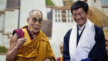Lobsang Sangay, President of the Tibetan government-in-exile, right, smiles as he listens to the Dalai Lama in Dharmsala, India.