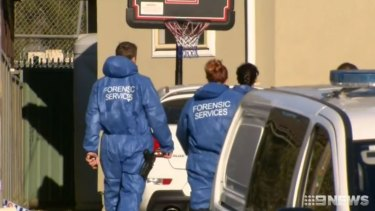 Forensic officers attend a home at Eastern Creek where a man was found with fatal head injuries.
