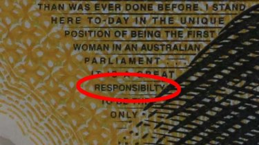 The fine print on the botched $50 note.