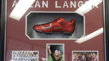 A signed boot from Allan Langer is among the items collected and now catalogued by Ipswich City Council staff.