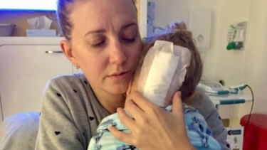 Luca McIlroy getting a much-needed loving hug from mum Brooke in hospital.