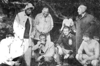 The survivors gather on the beach after escaping the yacht.
