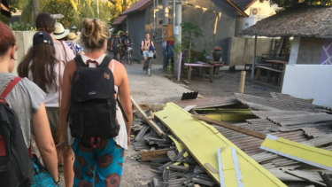 Mills and her friends walk past collapsed buildings on Gili Air.