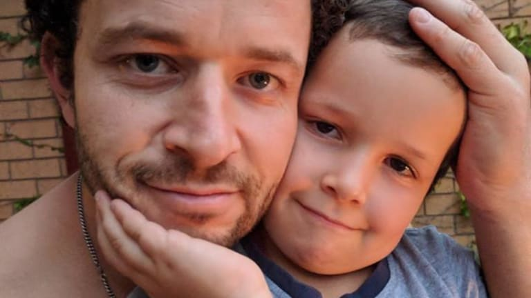 Cliff Mapham and his son Phoenix, who have been reunited after the six-year-old was found on Thursday afternoon.