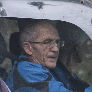 Ronald Doyle, seen leaving his Brisbane house,  is alleged to have helped his sons deal with proceeds of share sales.