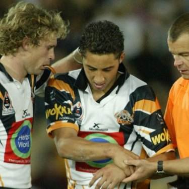Benji Marshall is taken from the field with a shoulder injury in 2004.