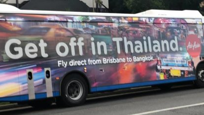 Airline apologises for 'inappropriate' advertisement on Brisbane buses