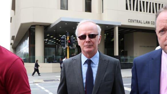 Father Joe Walsh outside of court.