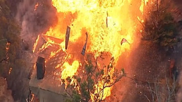 An aerial view of a house exploding in a massive fireball in Tonimbuk in theBunyipfire.