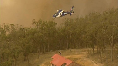 Footage taken from a Channel 9 helicopter shows David Key's crew struggling to rescue four people from Coombs Road, in Kinglake West. Key was cut from his line and managed to rescue the people and their horses.