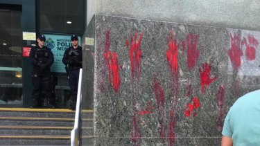 Red handprints were left outside police headquarters in Roma Street, Brisbane, during the Black Lives Matter protest.