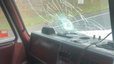 One of the rocks shattered the windscreen of the truck.