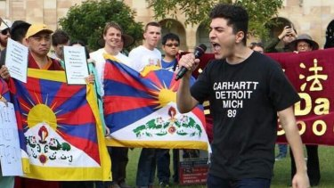 Activist Drew Pavlou speaks at a protest at UQ.