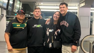 Roosters ace Joey Manu was re-united with his father Nooroa (far left) and mother Darnel for the first time in 15 months earlier this year. Also pictured is Joey's younger brother, Kani.