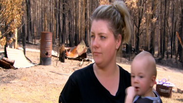 "Mogo resident Melinda Evans, with son Michael, said she had been told by four Centrelink workers she was ""not in the area [affected by bushfires]""."