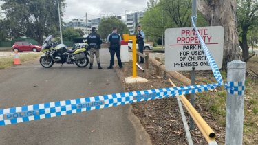 Police seal off a car park in the Canberra suburb of Barton.