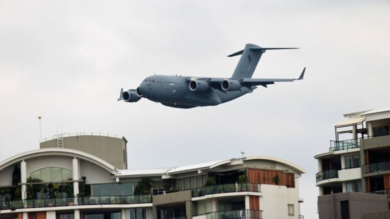 The C-17A Globemaster flys low over the Brisbane CBD on Thursday.