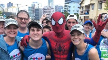 Maxwell Shearer (second from the left) has raised more than $100,000 for cancer research.