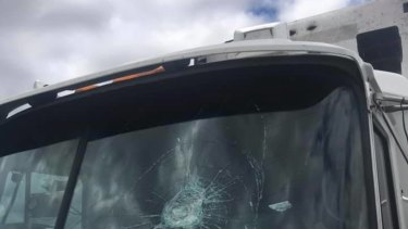 The impact of the rock shattered the windscreen of the truck.