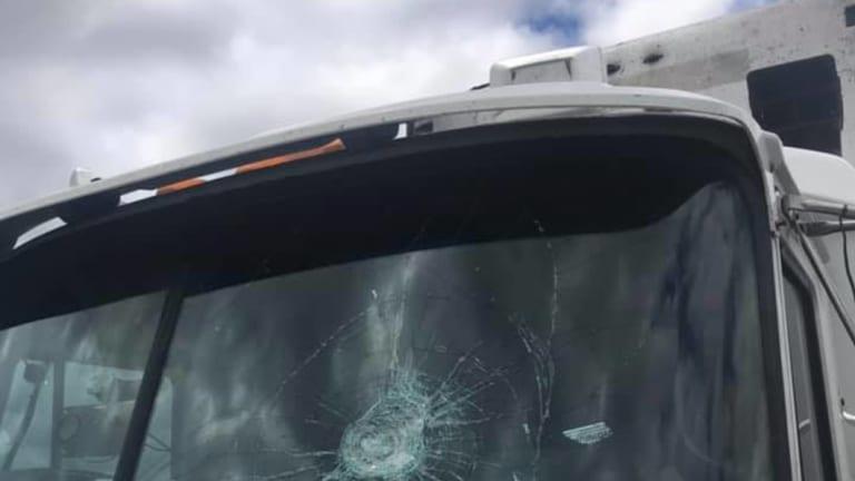 The impact of rocks broke the truck's windshield.