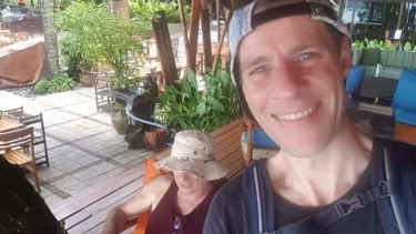 Adam with a friend on a holiday in Phuket.