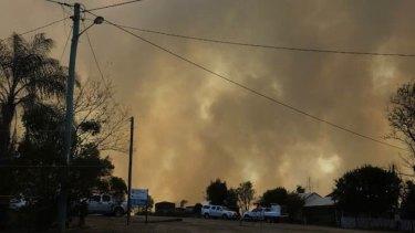 Dark smoke blankets areas north-west of Gympie in the Wide Bay region.