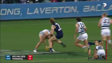 Nat Fyfe collides with Geelong's Andrew Mackie.