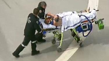 Tony Mokbel shakes the hand of a paramedic at Royal Melbourne Hospital.