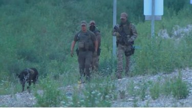 Police officers search for the teens near Gillam, Manitoba.