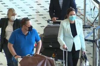 Premier Annastacia Palaszczuk and Brisbane lord mayor Adrian Schrinner arrive at Brisbane Airport on Sunday.