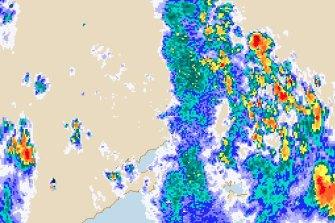 BOM's rain radar shows heavy rain north-east of Melbourne.