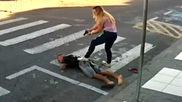 Sastre pinned him down until police arrived.