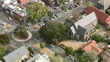 Police have arrested a man near St Mary's church in North Melbourne