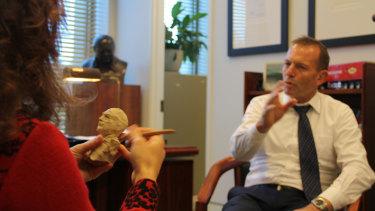 Sculptor Linda Klarfeld works with former prime minister Tony Abbott on a bust for Ballarat
