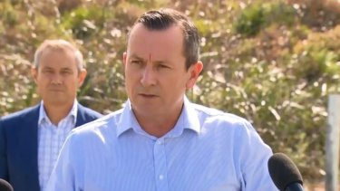 WA Premier Mark McGowan and Health Minister Roger Cook (background).