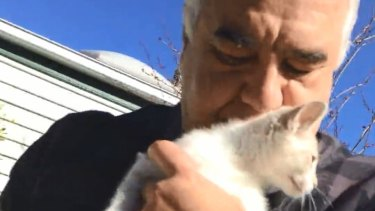 Video stills of Con and Liudmilla Petropoulos allegedly selling kittens in a park at Flemington.