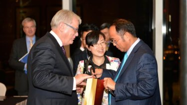 Huang with then Trade Minister Andrew Robb in Hong Kong in 2014.