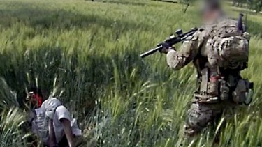A still from a video shows an Australian soldier allegedly about to shoot a subdued Afghan man in 2012.