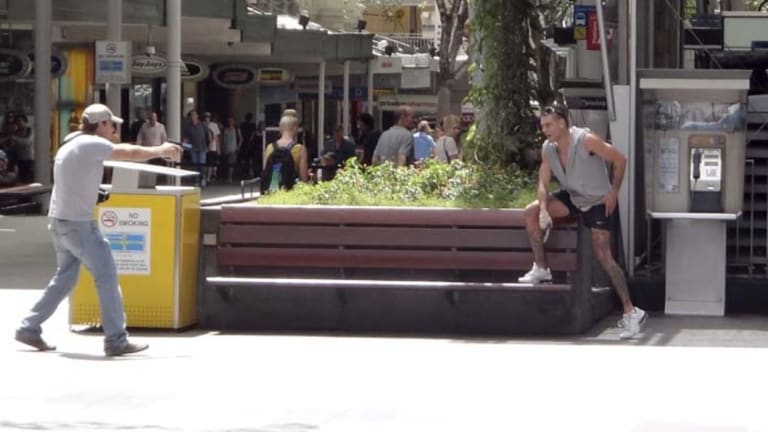 Lee Matthew Hillier, pictured being confronted by an armed police officer, locked down the Queen Street Mall in March 2013.