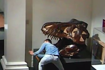 A man police allege is Paul Kuhn was captured on CCTV taking a selfie with his head inside a dinosaur skull.
