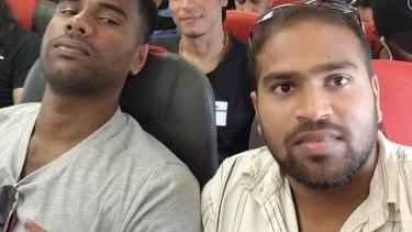 Shaminda Kanapathi, right, on the plane from Manus Island to Port Moresby on Thursday.