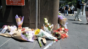 The number of floral tributes left in Bourke Street on Saturday grew as the day wore on.