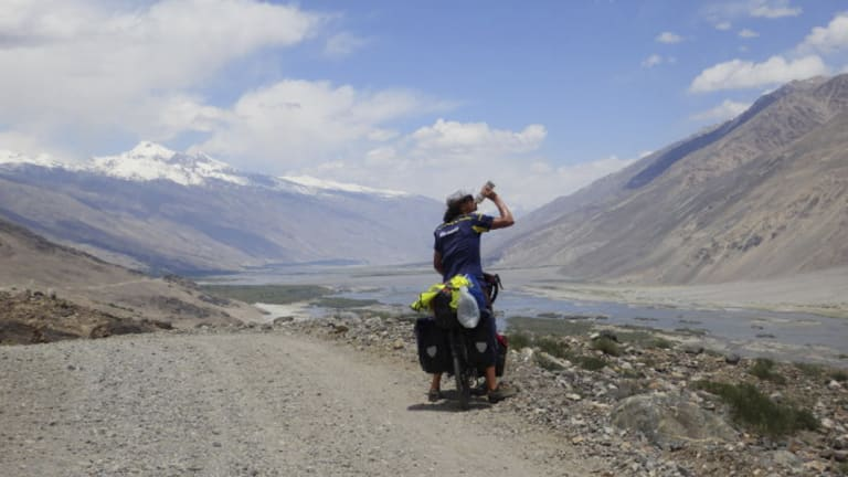 Ashley Doncon rode his pushbike 35,000km around the world and will arrive home in Perth on Saturday August 11.