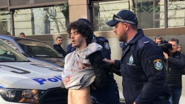 Mert Ney is arrested after being detained by members of the public on Tuesday.