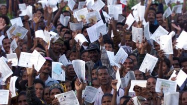 Huge crowds of East Timorese defied threats of violence to flock to polling stations, dressed in their Sunday best, clutching their identification papers.
