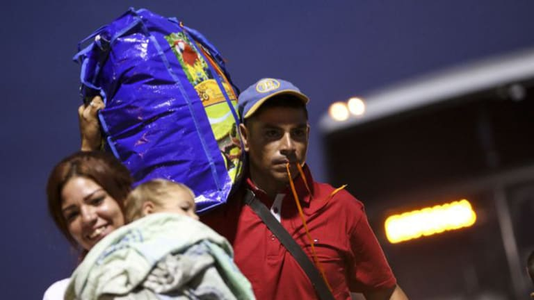 A Venezuelan couple prepares to board a plane bound for Sao Paulo in Boa Vista. Several Brazilian states have agreed to take migrants to ease the pressure on the Venezuelan border.