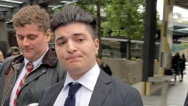 Suspended UQ student Drew Pavlou leaves Brisbane Magistrates Court last month after a hearing in the case he has brought against Brisbane's Chinese Consular-General Xu Jie.