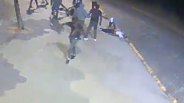 An image showing the man being robbed after he was bashed unconscious.
