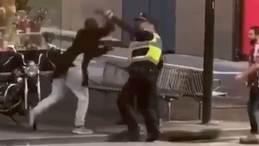 Police officers attacked by the Bourke Street terrorist in November. He was shot dead.