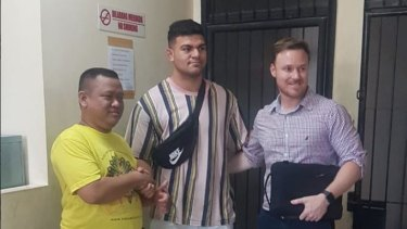 David Fifita (centre) with alleged assault victim Dani Irawan and Broncos staff member Adam Walsh.